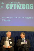 Dave Prentis, UNISON Gen. Sec, with Rev John Smith, Director of the Evangelical Alliance, on the platform of the London Citizens Mayoral Accountability Assembly in Central Hall, Westminster. - Philip Wolmuth - 04-05-2004