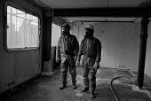Workers prepare to remove asbestos from a flat in Chantry Point, before demolition of the twenty storey block on Elgin Estate in North Paddington, London. - Philip Wolmuth - 1990s,1995,Asbestos,Asbestoses,ASBESTOSIS,cities,city,Council Services,Council Services,danger,dangerous,DEMOLISH,DEMOLISHED,demolition,developer,developers,DEVELOPMENT,equipment,flat,hazard,hazardous