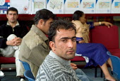 Newly arrived Iraqi Kurdish refugees wait interview at the Migrant Helpline Induction Centre in Dover. The interview determines elegibility for support by the National Asylum Support Service (NASS). - Philip Wolmuth - 2000s,2004,application,applications,Asylum Seeker,Asylum Seeker,BAME,BAMEs,black,BME,bmes,Diaspora,dispersal,dispersing,displaced,diversity,ethnic,ethnicity,foreign,foreigner,foreigners,immigrant,immi