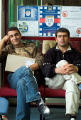 Newly arrived Iraqi Kurdish refugees wait interview at the Migrant Helpline Induction Centre in Dover. The interview determines elegibility for support by the National Asylum Support Service (NASS). - Philip Wolmuth - ,2000s,2004,application,applications,Asylum Seeker,Asylum Seeker,BAME,BAMEs,black,BME,bmes,card,cards,Diaspora,dispersal,dispersing,displaced,diversity,ethnic,ethnicity,foreign,foreigner,foreigners,id