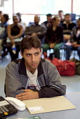 A newly arrived Iraqi Kurdish refugee speaks with an interpreter during an interview at the Migrant Helpline Induction Centre in Dover. The interview determines elegibility for housing and financial s... - Philip Wolmuth - ,2000s,2004,application,applications,Asylum Seeker,Asylum Seeker,BAME,BAMEs,bilingual,black,BME,bmes,card,cards,communicating,communication,Diaspora,dispersal,dispersing,displaced,diversity,ethnic,eth