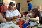 An Iraqi Kurdish refugee and her daughter at a weekly drop-in session for asylum seekers at the St. Paul's Church Centre in Dover, run by volunteers from the local community. - Philip Wolmuth - 21-07-2004