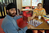 A newly arrived Sikh couple from Afghanistan play chess at a weekly drop-in session for asylum seekers at the St. Paul's Church Centre in Dover, run by volunteers from the local community. - Philip Wolmuth - 21-07-2004