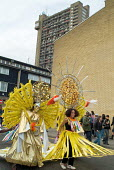 Parade passes Trellick Tower during Notting Hill Carnival, London - Philip Wolmuth - 30-08-2004