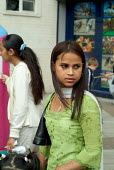 A young Bangladeshi girl at a community festival, Paddington, London. - Philip Wolmuth - 2000s,2004,adolescence,adolescent,adolescents,asian,asians,BAME,BAMEs,Bangladeshi,Bangladeshis,black,BME,bmes,cities,city,communities,community,diversity,ethnic,ethnicity,female,females,festival,FESTI