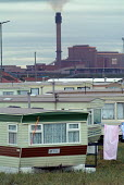 Mobile homes close to the Corus steelworks in Redcar - Philip Wolmuth - 2000s,2004,capitalism,caravan,caravans,chimney,chimneys,EBF economy,eni environmental issue,environment,environmental degradation,FACTORIES,factory,home,homes,housing,Industries,INDUSTRY,maker,makers,
