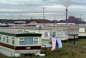 Mobile homes close to the Corus Teesside steelworks in Redcar - Philip Wolmuth - 2000s,2004,air pollution,capitalism,caravan caravans,chimney,chimney chimneys,chimneys,COAST,coastal,coasts,EBF,EBF Economy,Economic,Economy,eni,environment,environmental,Environmental degradation,Env