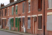 Boarded up empty and vandalised terraced housing in a low demand area of South Bank, Middlesbrough - Philip Wolmuth - 28-09-2004