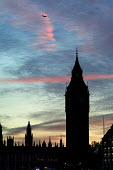 An aeroplane passes over Big Ben and the Houses of Parliament - Philip Wolmuth - 11-11-2004