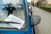 Parking ticket on the windscreen of a car in London - Philip Wolmuth - 04-11-2004