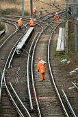Railway workers employed by a private contractor carry out work on the Silverlink line in Stratford, close to the proposed site of the 2012 Olympic Games in East london. - Philip Wolmuth - 10-02-2005