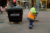 A street cleaner employed by private contractor Onyx sweeps up in Leicester Square, London. - Philip Wolmuth - 13-02-2005