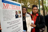 Not Another Drop anti-gun crime march, Cheryl Sealey, organiser of Community Victim Liaison, and Brent MP Dawn Butler lay a wreath opposite the Harlesden flat in which Toni-Ann Byfield and her father... - Philip Wolmuth - ,2000s,2005,activist,activists,afro-caribbean,and,BAME,BAMEs,black,BME,BME Black minority ethnic,bmes,CAMPAIGN,campaigner,campaigners,CAMPAIGNING,CAMPAIGNS,communities,Community,crime,DAD,DADDIES,DADD