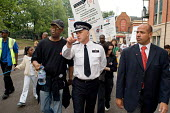 Chief Superintendent Andy Bamber marching with Not Another Drop campaign protest at black-on-black gun crime, Harlesden, London - Philip Wolmuth - 10-09-2005