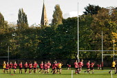 Rugby training on playing fields in Cricklewood, London, belonging to University College School for Boys. UCS is a private, fee-paying school. - Philip Wolmuth - 2000s,2005,adolescence,adolescent,adolescents,AFFLUENCE,AFFLUENT,Bourgeoisie,child,CHILDHOOD,children,cities,city,College,COLLEGES,EDU Education,elite,elitism,EQUALITY,exercise,exercises,exercising,fi