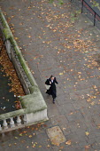 A woman walks along the Embankment in central London in autumn. - Philip Wolmuth - 02-11-2005