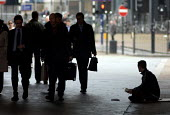 A homeless young man begs from passing commuters in Waterloo, central London. - Philip Wolmuth - 02-11-2005