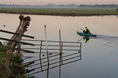A man paddles a canoe on the River Thames in Port Meadow, Oxford, at dusk - Philip Wolmuth - 21-10-2005