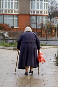 An elderly woman using walking sticks in south London. - Philip Wolmuth - 12-12-2005