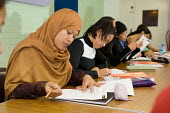 Sunday morning ESOL English class for migrant domestic workers organised by community organisation Kalayaan and run at the Venture Centre, North Kensington, by Kensington and Chelsea College. The wome... - Philip Wolmuth - 25-09-2005