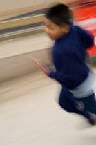 Boy running in a school playground - Philip Wolmuth - 26-05-2005