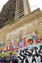 Graffiti below Trellick Tower in North Kensington, London. - Philip Wolmuth - 2000s,2006,ACE,anti-social,architecture,behavior,behaviour,buildings,cities,city,council,culture,estate,ESTATES,flat,flats,government,Graffiti,High Rise,high-rise,homes,housing,Kensington,landscape,LA
