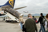 Passengers walk to a Ryanair plane at Bergamo airport - Philip Wolmuth - 02-05-2006
