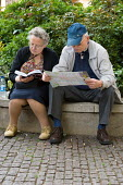 Elderly tourists look at a map and a guide book in central London - Philip Wolmuth - 11-05-2006