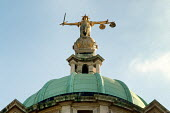The figure of Justice by Frederick William Pomeroy on top of the Old Bailey Central Criminal Court, London - Philip Wolmuth - 2000,2000s,ACE,arts,artwork,artworks,cities,city,CLJ,court,courts,crime,Criminal,CRIMINALS,Crown Court,figure,Goddess,hand,image,images,in,justice,law,London,of,one,scales,sculpture,sculptures,statue,