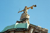 The figure of justice, by Frederick William Pomeroy, on top of the Old Bailey Central Criminal Court in London - Philip Wolmuth - 2000,2000s,ACE arts,artwork,artworks,cities,city,CLJ crime law & justice,court,courts,Criminal,CRIMINALS,Crown Court,figure,Goddess,hand,image,images,in,justice,law,London,of,one,scales,sculpture,SCUL