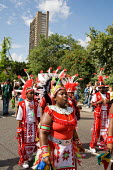 Childrens day parade at Notting Hill Carnival passes Trellick Tower in North Kensington. - Philip Wolmuth - 27-08-2006