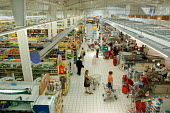 Hyper-U supermarket in northern France - Philip Wolmuth - ,2000s,2006,bought,buy,buyer,buyers,buying,checkout,check-out,commodities,commodity,consumer,consumers,consumption,customer,customers,EBF Economy,eu,Europe,european,europeans,eurozone,food,FOODS,franc
