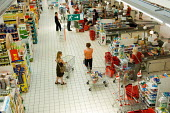 Hyper-U supermarket in northern France - Philip Wolmuth - 2000s,2006,bought,buy,buyer,buyers,buying,checkout,check-out,commodities,commodity,consumer,consumers,consumption,customer,customers,EBF Economy,eu,Europe,european,europeans,eurozone,food,FOODS,france