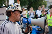 """Anti-war activist Brian Haw addresses a """"mass lone demonstration"""" in Parliament Square against the ban on unauthorised protests within one kilometre of the Houses of Parliament. - Philip Wolmuth - 31-08-2006"""