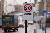 20 mph speed limit signs in Lewisham, London. - Philip Wolmuth - 2000s,2005,AUTO,AUTOMOBILE,AUTOMOBILES,AUTOMOTIVE,calming,CAR,cars,cities,city,communicating,communication,CONGESTED,congestion,ENI environmental issues,highway,journey,journeys,PARKED,parking,road,ro