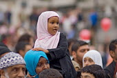 First ever celebration in Trafalgar Square of the Muslim festival of Eid ul-fitr, which marks the end of Ramadan - Philip Wolmuth - 2000s,2006,CELEBRATE,CELEBRATING,celebration,CELEBRATIONS,child,CHILDHOOD,children,cities,city,dress,female,females,festival,FESTIVALS,girl,girls,hajib,headscarf,hijab,Holy,Islam,Islamic,juvenile,juve