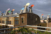 Rotating ventilation cowls on the roof and solar panels on the south-facing wall of a building at the Beddington Zero Energy Development BedZED in the London Borough of Sutton. The 82 mixed tenure hou... - Philip Wolmuth - 08-01-2007
