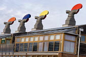 Rotating ventilation cowls on the roof of a building at the Beddington Zero Energy Development BedZED in the London Borough of Sutton. Warm air extracted from the highly insulated buildings heats cold... - Philip Wolmuth - 08-01-2007