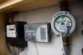 Water, electricity and energy consumption meters in the kichen of a maisonette at the Beddington Zero Energy Development BedZED in the London Borough of Sutton. The 82 mixed tenure housing units, part... - Philip Wolmuth - 08-01-2007