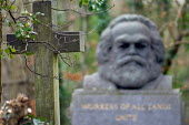 A cross on a grave opposite the tomb of Karl Marx, Highgate Cemetery, London - Philip Wolmuth - 23-01-2007