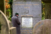 A visitor pays his respects at the tomb of Karl Marx in Highgate Cemetery, London. - Philip Wolmuth - 2000s,2007,ace culture,Borough,buried,Camden,cemeteries,Cemetery,cities,city,communism,communist party,communists,dead,death,DEATHS,died,grade 1,grade one,grave,graves,gravestone,gravestones,graveyard