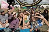Bicycle repair workshop at the Camp for Climate Action at Heathrow, West London, the world's busiest airport. - Philip Wolmuth - 2000s,2007,3rd,activist,activists,against,Bicycle,BICYCLES,BICYCLING,Bicyclist,Bicyclists,BIKE,BIKES,Camp,campaign,campaigner,campaigners,campaigning,CAMPAIGNS,camps,Climate Change,CYCLE,cycles,CYCLIN
