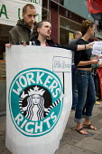 Demonstration outside a central London branch of Starbucks Coffee, organised by No Sweat and IWW, to protest at the multinational company's anti-union and low pay policies. - Philip Wolmuth - 18-08-2007