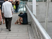 A man begging on Hungerford Bridge, in Waterloo, Central London. - Philip Wolmuth - 11-08-2007