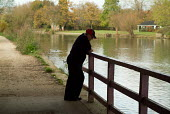 A man leans on railings by the River Cherwell in Oxford - Philip Wolmuth - 2000s,2007,adult,adults,age,ageing population,depressed,depression,disturbed,elderly,intelligence,intelligent,Leisure,LFL,LFL Leisure,LIFE,male,man,MATURE,memory,men,OAP,OAPS,old,older,outdoors,Oxford