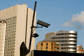 A surveillance camera overlooks construction work on Merchant Square at Paddington Basin, in front of the completed West End Quay development and the Hilton London Metropole hotel. - Philip Wolmuth - 07-03-2008