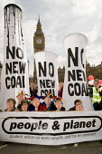 People & Planet Fossil Fools Day protest outside Parliament against a proposal to build a new coal fired power station in Kingsnorth, Kent. - Philip Wolmuth - 2000s,2008,activist,activists,against,Big Ben,CAMPAIGN,campaigner,campaigners,CAMPAIGNING,CAMPAIGNS,Climate Change,co2,coal,DEMONSTRATING,demonstration,DEMONSTRATIONS,emissions,energy,eni environmenta