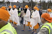 Thousands of local residents join a procession through Southall, West London, to celebrate the Sikh festival of Vaisakhi. - Philip Wolmuth - 2000s,2008,asian,asians,Baisakhi,BLACK,BME Black minority ethnic,CELEBRATE,CELEBRATING,celebration,CELEBRATIONS,cities,city,communities,community,culture,festival,FESTIVALS,local,London,male,man,men,p