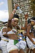 Dancers pass by the landmark Trellick Tower on Childrens Day at Notting Hill Carnival - Philip Wolmuth - 24-08-2008