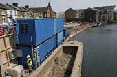 A barge delivers materials to a Genesis Housing Group construction site by the Grand Union Canal, close to the Harrow Road in North Paddington, London. - Philip Wolmuth - 13-05-2008